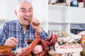 Ordinary Men With Lots Of Meat And Sausage Products Stock Photos - 82001043