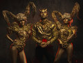 Beautiful Devil Women With Golden Ornamental Horns And Handsome Devil Man In Ornamental Jacket Royalty Free Stock Images - 82004679