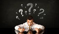 Sitting Businessman Under Question Marks Royalty Free Stock Photo - 82063245