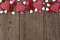 Valentines Day Heart Shaped Candy Top Border On Rustic Wood Royalty Free Stock Photos - 82104898