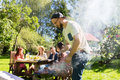 Man Cooking Meat On Barbecue Grill At Summer Party Royalty Free Stock Photo - 82134465