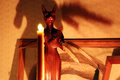 Statuette Of The Goddess Bastet And Ritual Candle On The Altar. Royalty Free Stock Photo - 82138195