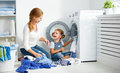 Family Mother And Child Little Helper In Laundry Room Near Washi Royalty Free Stock Photo - 82147385