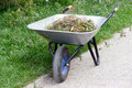 Cleaning And Gardening With Wheel Barrow Royalty Free Stock Images - 82148029