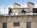 Take Off The Snow And Icicles From The Roof. Working Cleaning Work Without Insurance. Russia, St. Petersburg Stock Images - 82154554