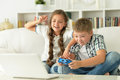 Brother And Sister Play Videogames Royalty Free Stock Photos - 82173088