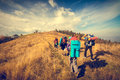 Young People Are Hiking In Mountains Royalty Free Stock Photography - 82187017