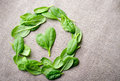 Fresh Baby Spinach Leaves On Sackcloth Background. Top View With Copy Space, Round Circle Frame. Love, Healthy, Ecology Royalty Free Stock Images - 82195679
