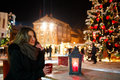 Long Hair Girl On European Christmas Market. Young Woman Enjoying Winter Holiday Season. Blurred  Lights Background, Dusk. Cups Wi Stock Photo - 82211250