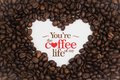 Background Made Of Coffee Beans In A Heart Shape With Message `You`re The Coffee Of My Life` Royalty Free Stock Images - 82215339
