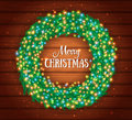 Christmas Wreath, Colourful Glowing Garland, Lights. Wood Texture. Greeting Cards Stock Photo - 82215910