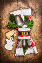 Beautiful Rustic Christmas Table Place Setting With Cutlery, Decorated With Napkin, Fir Twigs , Handmade Snowman And Tag On Wooden Royalty Free Stock Image - 82222446