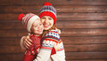 Happy Family Mother And Child Girl With Christmas Hat Hugs At Wo Royalty Free Stock Photo - 82252545