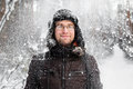 Man In Fur Winter Hat With Ear Flaps Smiling Stock Photos - 82313043
