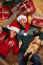 Relaxing On Floor With Christmas Gifts Stock Photo - 82318980