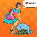 Pop Art Young Housewife Hiding Money Under The Rug Royalty Free Stock Images - 82335539