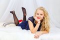 Young Teenage Girl Lying On Bed Stock Images - 82393164