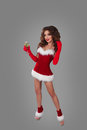 Beautiful Woman In Christmas Dress On The Grey Background In Full Height With Glass Of Champagne And Looking At Camera. Stock Photography - 82395192