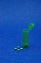 Small Green Pills With A Little Green Pill Bottle Royalty Free Stock Image - 82493916