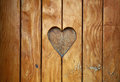 One Heart Shape Carved In Vintage Wood Close Up Stock Photo - 82504450