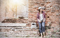 Hipster Girl Leaning Against The Old Temple Wall. Stock Images - 82507734