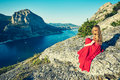 Young Beautiful Woman In Red Dress Looking To Mountains Sea Stock Photography - 82508802