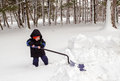 Small Boy Trying To Shovel Snow Stock Photos - 82530013