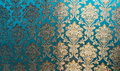 The Texture Of Silk With A Floral Pattern. Chinese Silk Brocade, Beautiful Expensive Fabric Background. Gold Ornament Turquoise Em Royalty Free Stock Photo - 82539705