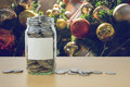 Money In The Glass Bottle With Decorated Christmas Tree Backgrou Stock Photos - 82570903