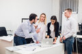 Group Young Coworkers Making Great Business Decisions.Creative Team Discussion Corporate Work Concept Modern Office Stock Photos - 82586683