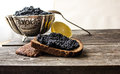 Black Caviar In A Silver Bowl With Bread And Lemon On A Wooden Background Royalty Free Stock Image - 82618686