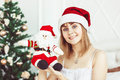 Santa Girl With A Toy Stock Photo - 82623010