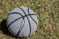Worn Basketball In Grass Royalty Free Stock Photo - 82629605