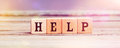 Word Help With Wood Cubes On Table Royalty Free Stock Photo - 82638965