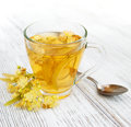 Cup Of Herbal Tea With Linden Flowers Royalty Free Stock Image - 82658156