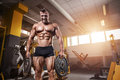 Muscular Bodybuilder Guy Doing Exercises With Dumbbell Royalty Free Stock Photos - 82676728