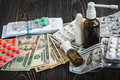 Of Dollars On The Table On The Background Of Medical AIDS, Expensive Drugs Stock Photos - 82678943
