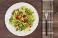 Salad From Beef Tongue, Chinese Cabbage, Peppers, Corn, Parsley And Basil. Wooden Background. Top View Royalty Free Stock Photos - 82681588