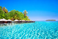 Overwater Bungalows On Tropical Island With Sandy Beach, Palm Trees And Beautiful Lagoon Stock Images - 82681814
