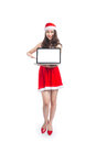 Asian Christmas Girl With Santa Claus Clothes Holding Laptop Iso Royalty Free Stock Photos - 82702788