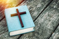 Closeup Of Wooden Christian Cross On Bible, Burning Candle And Prayer Beads On The Old Table. Stock Photos - 82715513