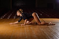 Tired Ballet Dancer Girl Crawling On Stage Of The Theater Stock Image - 82718651