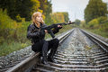 Girl With Arms On The Rails In Autumn Stock Photos - 82735723