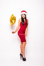 Woman In Red Dress And Santa Christmas Hat With Gold Star Shaped Balloon Royalty Free Stock Photos - 82737528