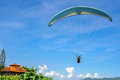 Back Of The Paragliding Man In Blue Sky At Camboinhas Beach, Niteroi, Rio De Janeiro, Brazil Royalty Free Stock Images - 82738169