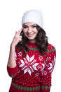 Smiling Pretty Sexy Young Woman Wearing Colorful Knitted Sweater With Christmas Ornament And Hat. Isolated On White Background. Stock Photos - 82746513