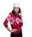 Smiling Pretty Sexy Young Woman Wearing Colorful Knitted Sweater With Christmas Ornament And Hat. Isolated On White Background. Stock Photo - 82746720