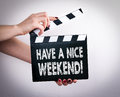 Have A Nice Weekend. Female Hands Holding Movie Clapper Royalty Free Stock Photography - 82756427