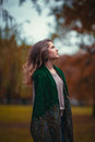 Portrait Of A Young Girl With  Green Scarf On The Background  Autumn Park. Royalty Free Stock Images - 82763269