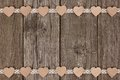 Double Border Of Wooden Hearts And Ribbon Lace Over Wood Royalty Free Stock Photo - 82799405